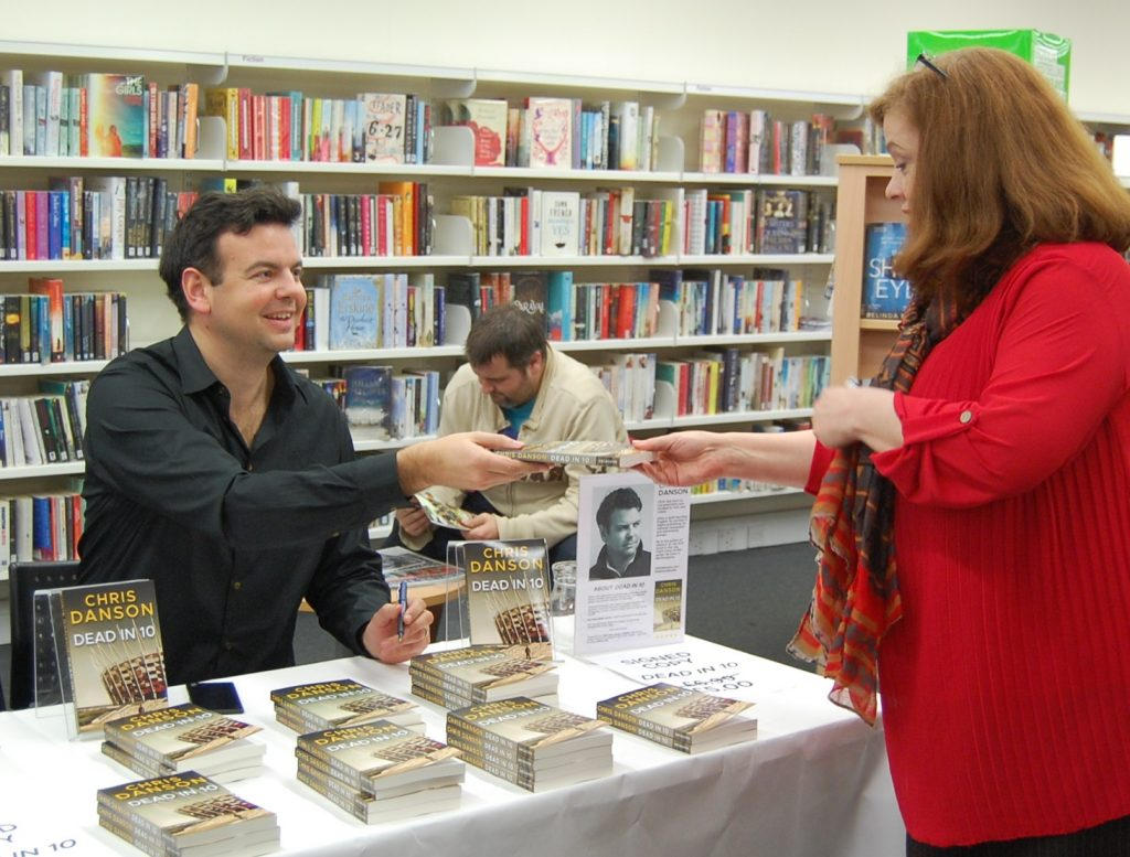 Signing books at Harpenden library.