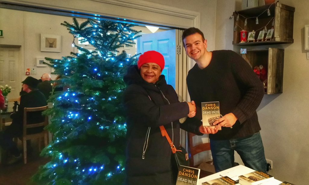 Meeting a reader at the Watford book signing event, 12th December 2018